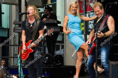 "Stock Image of Jack Blades, left, and Brad Gillis from the band ""Night Ranger"" perform with Anna Kooiman on 'FOX and Friends' All American Summer Concert Series, in New York"