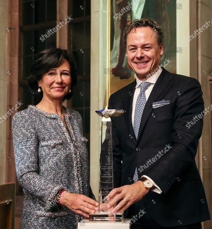 Ana Botin (L), Group Executive Chairman of Banco Santander, presents the award 'European Banker of the Year 2016' to Ralph Hamers (R), CEO & Chairman Executive Board of ING Group during ceremony at Imperial Hall of the Frankfurt Roemer in Frankfurt Main, Germany, 13 November 2017. Ralph Hamers, CEO & Chairman Executive Board, ING Group, has worked for the company since 1991, and has headed the financial enterprise since 2013. As part of reasons for awarding the title, the awarding jury said ?under Hamers? leadership, ING has invested heavily in online banking and is considerably ahead of the curve when it comes to banking digitisation. The jury also said the bank impresses with its visionary applications and always stays up to date with the latest technological trends. In contrast to the general trend in the industry, ING?s German subsidiary once again achieved a record result for the 2016 financial year. Earnings after tax rose by 14 per cent to 859 million Euros.