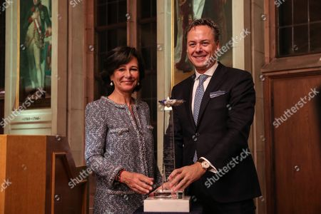 Ana Botin (L) Group Executive Chairman of Banco Santander present the award 'European Banker of the Year 2016' to Ralph Hamers, CEO & Chairman Executive Board of ING Group during ceremony at Imperial Hall of the Frankfurt Roemer in Frankfurt Main, Germany, 13 November 2017. Ralph Hamers, CEO & Chairman Executive Board, ING Group, has worked for the company since 1991, and has headed the financial enterprise since 2013. As part of reasons for awarding the title, the awarding jury said ?under Hamers? leadership, ING has invested heavily in online banking and is considerably ahead of the curve when it comes to banking digitisation. The jury also said the bank impresses with its visionary applications and always stays up to date with the latest technological trends. In contrast to the general trend in the industry, ING?s German subsidiary once again achieved a record result for the 2016 financial year. Earnings after tax rose by 14 per cent to 859 million Euros.