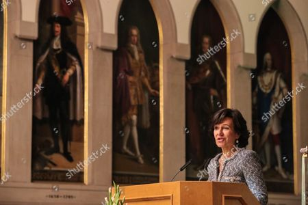 Stock Image of Ana Botin, Group Executive Chairman of Banco Santander present the award 'European Banker of the Year 2016'  during ceremony at Imperial Hall of the Frankfurt Roemer in Frankfurt Main, Germany, 13 November 2017. Ralph Hamers, CEO & Chairman Executive Board, ING Group, has worked for the company since 1991, and has headed the financial enterprise since 2013. As part of reasons for awarding the title, the awarding jury said ?under Hamers? leadership, ING has invested heavily in online banking and is considerably ahead of the curve when it comes to banking digitisation. The jury also said the bank impresses with its visionary applications and always stays up to date with the latest technological trends. In contrast to the general trend in the industry, ING?s German subsidiary once again achieved a record result for the 2016 financial year. Earnings after tax rose by 14 per cent to 859 million Euros.