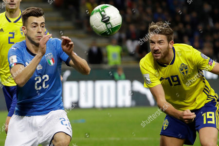 Italy's Stephan El Shaarawy, left, and Sweden's Marcus Rohden vie for the ball during the World Cup qualifying play-off second leg soccer match between Italy and Sweden, at the Milan San Siro stadium, Italy