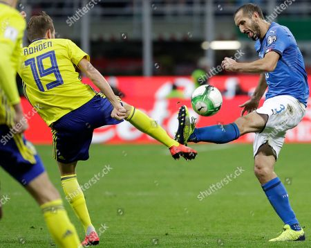 Sweden's Marcus Rohden, left, and Italy's Giorgio Chiellini vie for the ball during the World Cup qualifying play-off second leg soccer match between Italy and Sweden, at the Milan San Siro stadium, Italy