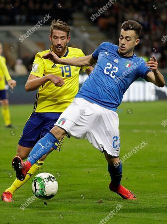 Sweden's Marcus Rohden, left, and Italy's Stephan El Shaarawy vie for the ball during the World Cup qualifying play-off second leg soccer match between Italy and Sweden, at the Milan San Siro stadium, Italy