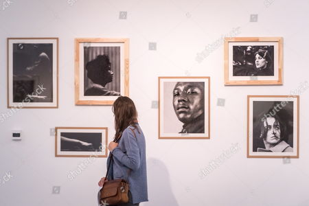 A visitor looks at photographs in the 'In The Stream of Time' exhibition of Lola Garrido collection with special presentation of Linda McCartney?s works in Bydgoszcz, Poland, 13 November 2017. The exhibition is an event accompanying the 25th Camerimage International Film Festival 2017.