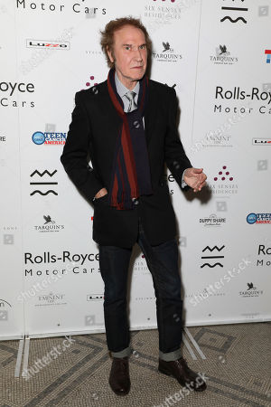Musician Ray Davies poses for photographers on arrival at the Adoration Trilogy Event at the Victoria and Albert Museum in London, . The event unveils a photographic collaboration of iconic musicians and raises funds for the Teenage Cancer Trust