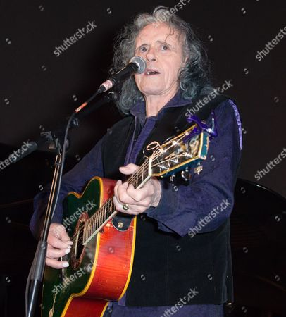 Stock Image of Donovan - performing at the opening of 'The Adoration Trilogy - Searching For Apollo', a mixed media artwork installation hosted by Roger Daltrey and Alistair Morrison of 'Legendary Musicians' photograph for Teen Cancer America & Teenage Cancer Trust