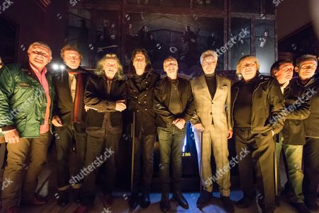 Carl Palmer, Sir Ray Davies, Donovan, Alice Cooper, Peter Frampton, Tom Jones, Bill Wyman, Kenned Jones, John Paul Jones - standing in front of the mixed media artwork installation