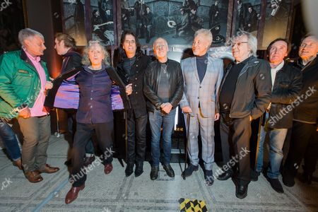 Carl Palmer, Sir Ray Davies, Donovan, Alice Cooper, Peter Frampton, Tom Jones, Bill Wyman, Kenney Jones, John Paul Jones - standing in front of the mixed media artwork installation