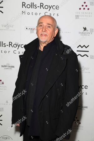 Musician Peter Gabriel poses for photographers on arrival at the Adoration Trilogy Event, at the Victoria and Albert Museum in London, . The event unveils a photographic collaboration of iconic musicians and raises funds for the Teenage Cancer Trust