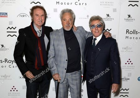 Ray Davies, Tom Jones, Roger Daltrey. Musicians, From left, Ray Davies, Sir Tom Jones and Roger Daltrey pose for photographers on arrival at the Adoration Trilogy Event, at the Victoria and Albert Museum in London, . The event unveils a photographic collaboration of iconic musicians and raises funds for the Teenage Cancer Trust