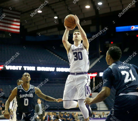 Nick Griffin, Bryant McIntosh, Julian Powell. Northwestern 's Bryant McIntosh (30) shoots between St. Peter's guard Nick Griffin (0) and Julian Powell during the second half of an NCAA college basketball game, in Rosemont, Ill. Northwestern won 75-66