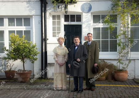 Stock Image of British actor Robert Powell who plays Poirot who stars in Agatha Christie's first ever play, Black Coffee, centre, poses alongside Liza Goddard, as Miss Caroline Amory, and Robin McCallum, right, as Poirot's friend and confidante Captain Arthur Hastings, during a photo call outside the west London residence of author Christie, in Cresswell Place, London, . The play opens a UK wide tour in Windsor this week, and was the only one to ever feature the Belgian detective