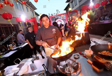Chef Jimmy Wang prepares Panda Express' General Tso's Chicken at Chinatown Summer Nights, in Los Angeles