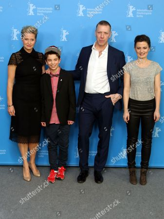 From left, actors Trine Dyrholm, Sofus Ronnov, Mikael Persbrandt and director Pernille Fischer Christensen attend the photo call for the film Someone You Love during the 64th Berlinale International Film Festival, in Berlin