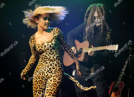 Stock Image of Kat de Luna, left, performs at the KIIS FM Halloween Party at the House of Rock benefitting The Painted Turtle, in Santa Monica, Calif