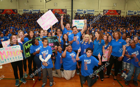 Mario Lopez along with Ross Ellis, STOMP OUT Bullying's founder and CEO, and students of Albert Leonard Middle School seen at the STOMP OUT Bullying Pep Rally with Mario Lopez, at Albert Leonard High School, on in New Rochelle, N.Y