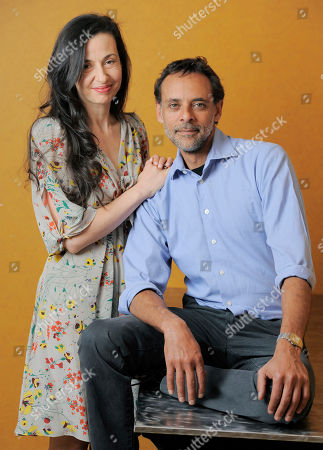 "Ruba Nadda, left, writer/director of the film ""Inescapable,"" poses for a portrait with cast member Alexander Siddig at the 2012 Toronto Film Festival, in Toronto"