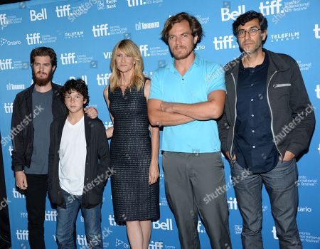 """Andrew Garfield, and from left, Noah Lomax, Laura Dern, Michael Shannon and Ramin Bahrani attends the press conference for """"99 Homes"""" on day 6 of the Toronto International Film Festival at the TIFF Bell Lightbox, in Toronto"""