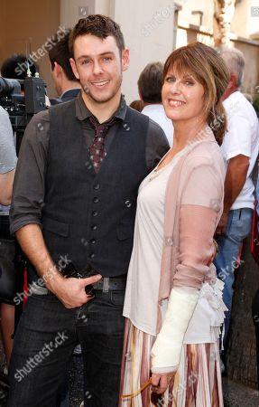Sean Harmon, son of actor Mark Harmon, left, and Pam Dawber attend a ceremony awarding Mark Harmon with a star on the Hollywood Walk of Fame, in Los Angeles