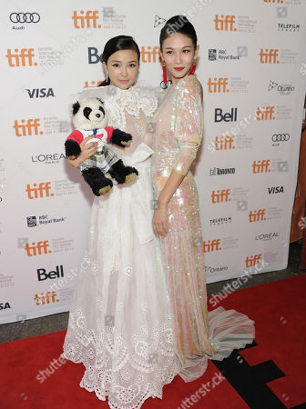 """Chinese actresses Yao Xingtong, left, and Zhang Lanxin arrive at """"In Conversation With Jackie Chan"""" during the Toronto International Film Festival on in Toronto"""