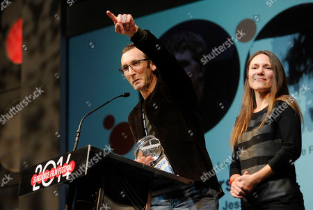 """Jesse Moss, director of """"The Overnighters,"""" accepts the U.S. Documentary Special Jury Award for Intuitive Filmmaking alongside his wife Amanda, a producer on the film, during the 2014 Sundance Film Festival Awards Ceremony in Park City, Utah. Residents in Williston, N.D., will get to view a a screening of the award-winning documentary about the gritty side of life in the oil boomtown"""