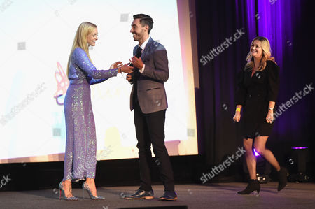 Mind ambassador Fearne Cotton (L) presents Hollyoaks cast members Ross Adams (C) and Alexandra Fletcher (R) with the award for Best Soap on stage at the Virgin Money Giving Mind Media Awards at Odeon Leicester Square
