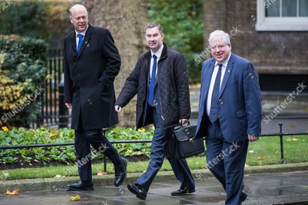 Transport Secretary Chris Grayling, Secretary of State for Work and Pensions David Gauke and Chairman of the Conservative Party Patrick McLoughlin arrive on Downing Street for the weekly Cabinet meeting.