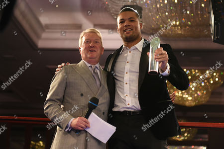 Stock Picture of Joe Joyce (R) receives a Special Achievement Award from Frank Warren during a Charity Dinner Boxing Show at the Hilton Hotel on 13th November 2017