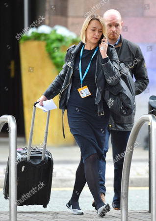 BBC political Editor Laura Kuenssberg and security guard 'Al' leave the Midland Hotel.