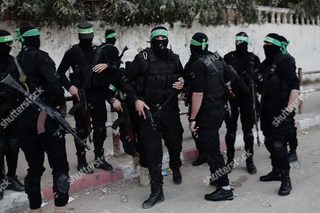 Fighters from the armed Palestinian military wings attend a military march marking the fifth anniversary of killing Ahmed Jabari, the late leader of the Ezz-Al Din Al Qassam Brigades, the armed wing of Palestinian Hamas movement, near his house in Al Shejaeiya neighborhood, east of Gaza City, 14 November 2017. Ahmed Jabari was killed in an Israeli airstrike on 14 November 2012.