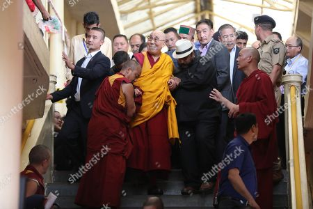 Tibetan spiritual leader the Dalai Lama is assisted to descend the stairs after giving teachings at the Tibetans' main temple of Tsuglhakhang at McLeod Ganj, near Dharamsala, India, 30 August 2017. At the heart of the Free Tibet movement are principals of non-violence and a middle way towards conflict resolution with China and a return to Tibet. Yet nearly six decades have passed since the soul of the movement and leader of peaceful resistance, the Dalai Lama, known also by his religious name as Tenzin Gyatso, the 14th spiritual head of Tibetan Buddhism, fled China controlled Tibet fearing his life. The Dalai Lama cites dreams stating that he will live until 113 years of age, but as decades pass and international attention strays to other conflicts, commentators now say Tibetan Buddhism is at a cross-roads. The reality of returning to Tibet, for those wishing for return, is very distant, according to assessments by independent observers.