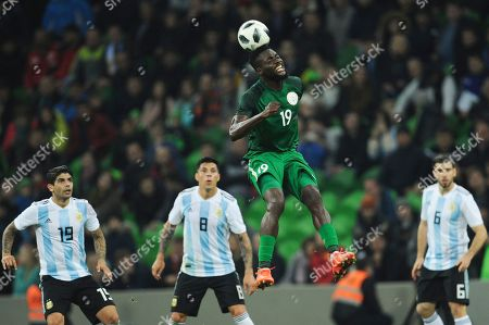 Nigeria's John Ogu, center right, jumps for the ball during the international friendly soccer match between Argentina and Nigeria in Krasnodar, Russia
