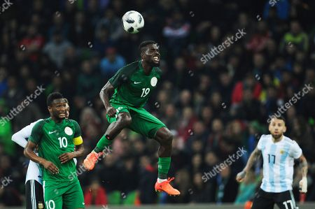 Nigeria's John Ogu, right, jumps for the ball during the international friendly soccer match between Argentina and Nigeria in Krasnodar, Russia