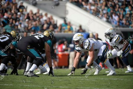 Joey Bosa, Josh Wells. Los Angeles Chargers defensive end Joey Bosa (99) works against Jacksonville Jaguars offensive lineman Josh Wells (72) during the first half of an NFL football game, in Jacksonville, Fla