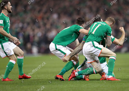 Republic of Ireland vs Denmark. Ireland's Shane Duffy celebrates scoring their first goal with James McClean and Stephen Ward