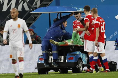 Stock Photo of Doctors help Andrey Lunyov (C) of Russia after being injured during international friendly soccer match between Russia and Spain in St. Petersburg, Russia, 14 November 2017.