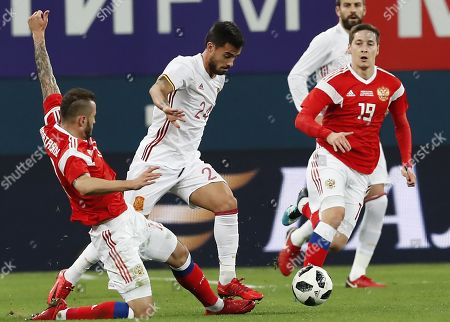 Fyodor Kudryashov (L) and Daler Kuzyayev (R) of Russia fight for the ball with  Suso Fernandez (C) of Spain during international friendly soccer match between Russia and Spain in St. Petersburg, Russia, 14 November 2017.