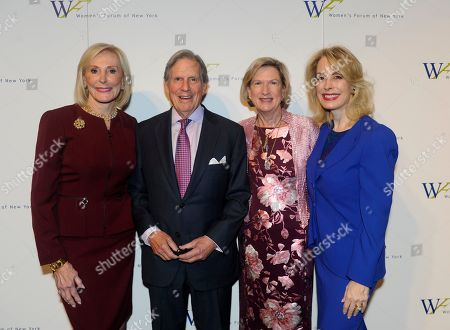 Janice Reals Ellig, Peter Grauer, Maggie Wilderotter, Carolyn Carter. Honorary Co-Chairs Peter Grauer, center left, and Maggie Wilderotter, center right, pose with Janice Reals Ellig, left, Chair, 2017 Breakfast of Corporate Champions, and Carolyn Carter, right, President, Women's Forum of New York at the 2017 Women's Forum of New York Breakfast of Corporate Champions, at Cipriani 42nd Street in New York