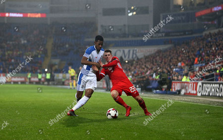 Ben Woodburn of Wales is tackled by Michael Amir Murillo of Panama.