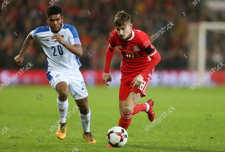 David Brooks of Wales is challenged by Ricardo Avila of Panama.
