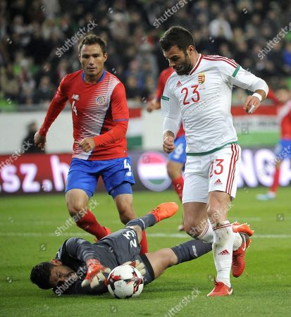 Nemanja Nikolic of Hungary (R) in action against Kenner Gutierrez (rear, L) and goalkeeper Leonel Moreira of Costa Rica during the international friendly soccer match between Hungary and Costa Rica in Goupama Arena in Budapest, Hungary, 14 November 2017.