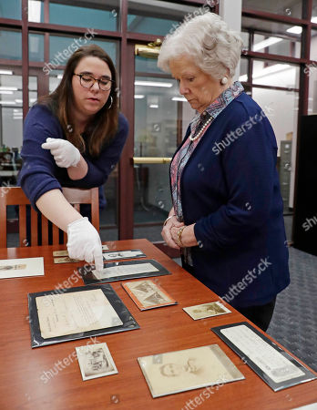 Kate Salter Gregory, Frances Coleman. HFS-In this photograph, Kate Salter Gregory, senior library associate specializing in President Abraham Lincoln exhibits, left, and Frances Coleman, dean of the Mississippi State University Libraries, examine a number of artifacts to be displayed in either the new Ulysses S. Grant Presidential Library or the Frank and Virginia Williams Collection of Lincolniana Gallery, both which are inside the Mitchell Memorial Library in Starkville, Miss. The 21,000 square foot facility has two galleries, a research room, a processing room, office space and a cold storage space and its museum portion features a variety of interactive exhibits