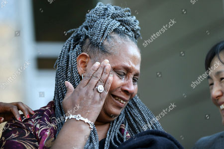 Wilda Jones, sister-in-law of Wilbert Jones, wipes away tears as family members and attorneys speak on the steps of state district court in Baton Rouge, La., . The Louisiana man who has spent nearly 50 years in prison will be freed after a judge overturned his conviction in the kidnapping and rape of a nurse. Judge Richard Anderson set Wilbert Jones' bail at $2,000 after hearing arguments from defense attorneys and prosecutors in a Baton Rouge courtroom. One of his lawyers expects him to be released Wednesday. Anderson threw out Jones' conviction on Oct. 31, saying authorities withheld evidence that could have exonerated Jones decades ago