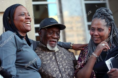 Plem Jones, Wilda Jones, Wajeedah Jones. Plem Jones, center, brother of Wilbert Jones, reacts with his wife Wilda Jones, right, and Wajeedah Jones, left, niece of Wilbert, on the steps of state district court in Baton Rouge, La., . The Louisiana man who has spent nearly 50 years in prison will be freed after a judge overturned his conviction in the kidnapping and rape of a nurse. State District Court Judge Richard Anderson set Wilbert Jones' bail at $2,000 after hearing arguments from defense attorneys and prosecutors in a Baton Rouge courtroom. One of his lawyers expects him to be released Wednesday. Anderson threw out Jones' conviction on Oct. 31, saying authorities withheld evidence that could have exonerated Jones decades ago
