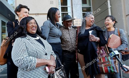 Family members of Wilbert Jones, flanked by attorneys from Innocence Project New Orleans, speak on the steps of state district court in Baton Rouge, La., . The Louisiana man who has spent nearly 50 years in prison will be freed after a judge overturned his conviction in the kidnapping and rape of a nurse. State District Court Judge Richard Anderson set Wilbert Jones' bail at $2,000 after hearing arguments from defense attorneys and prosecutors in a Baton Rouge courtroom. One of his lawyers expects him to be released Wednesday. Anderson threw out Jones' conviction on Oct. 31, saying authorities withheld evidence that could have exonerated Jones decades ago