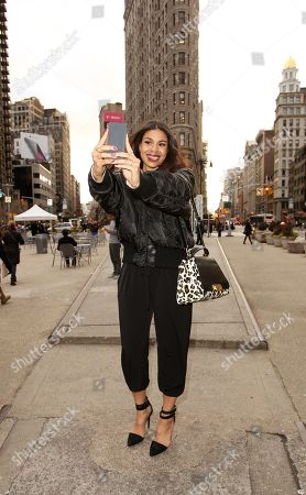 Stock Picture of Singer Jordan Sparks caught taking a selfie with her Lumia 830 while promoting the #MakeitHappen campaign in New York on