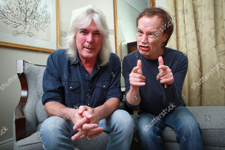 """Members of the rock band AC/DC, bassist Cliff Williams and guitarist Angus Young pose for a portrait in promotion of their upcoming album """"Rock or Bust"""" on in New York"""