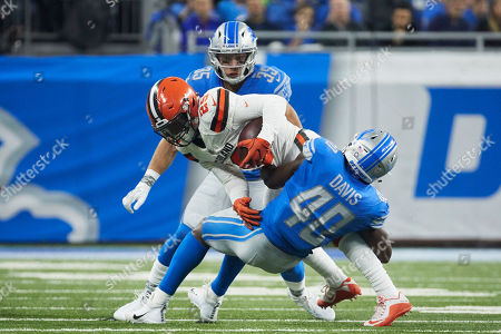 Duke Johnson, Jarrad Davis. Cleveland Browns running back Duke Johnson (29) is tackled by Detroit Lions linebacker Jarrad Davis (40) during an NFL football game, in Detroit