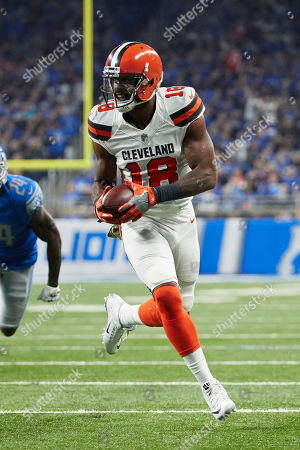 Cleveland Browns wide receiver Kenny Britt (18) runs the ball against the Detroit Lions during an NFL football game, in Detroit
