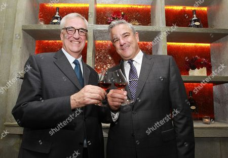 Stock Image of Hennessy Global Brand Ambassador and 8th generation family member, Maurice Hennessy left, and Rolls-Royce Head of Communications, Gerry Spahn, celebrate luxury originals at Hennessy X.O dinner on at The Baccarat Hotel in New York City. The private dinner featured casual conversation that shed light on both pioneering brands and how they've helped shape the trajectory of luxury goods